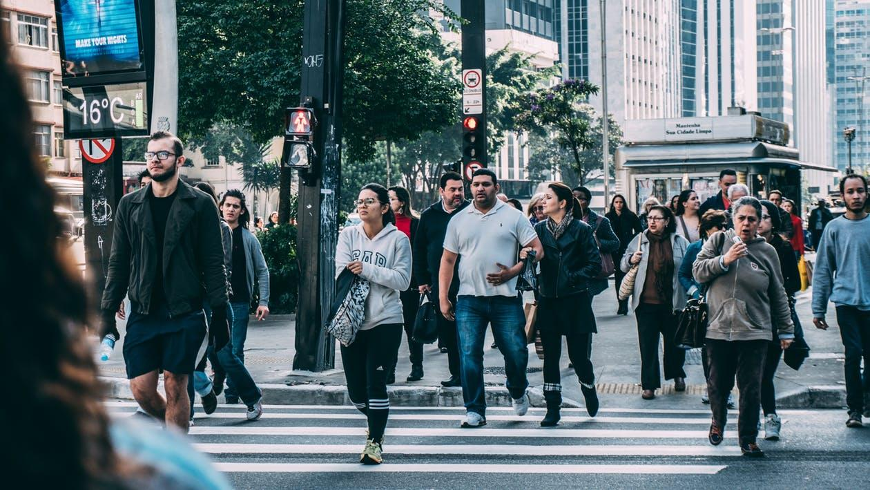 People Walking on Pedestrian Lane during Daytime
